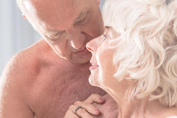 An elderly couple getting intimate