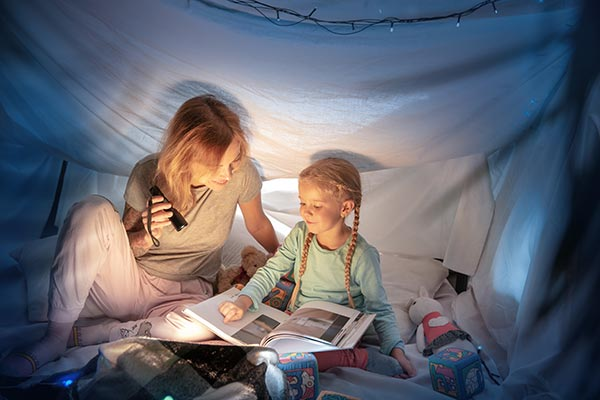 A mother and girl reading a book